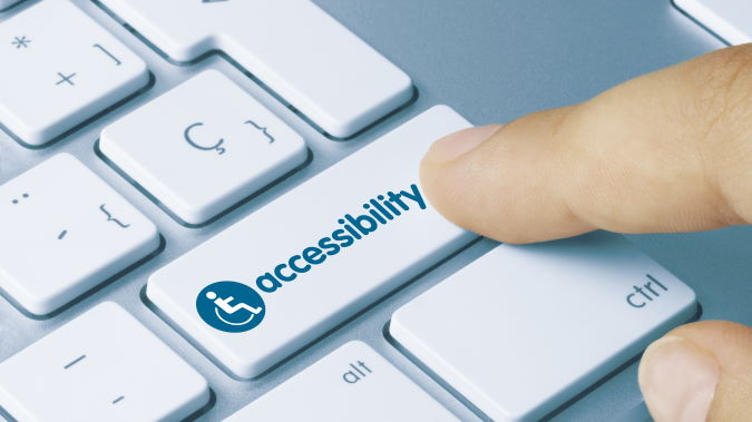 Accessibility Written on White Key of Metallic Keyboard. Finger pressing key